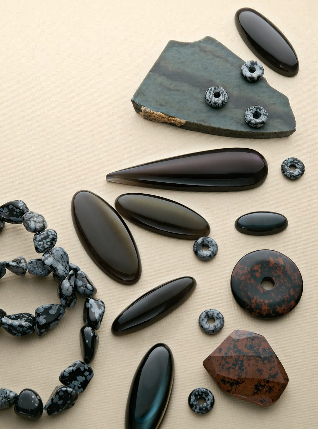 Obsidian is so much more than black. Here, the selection includes snowflake, sheen, rainbow, and mahogany obsidian. Stones cut by Bob Rush. As seen in the July 2010 issue of Lapidary Journal Jewelry Artist. Photo by Jim Lawson.