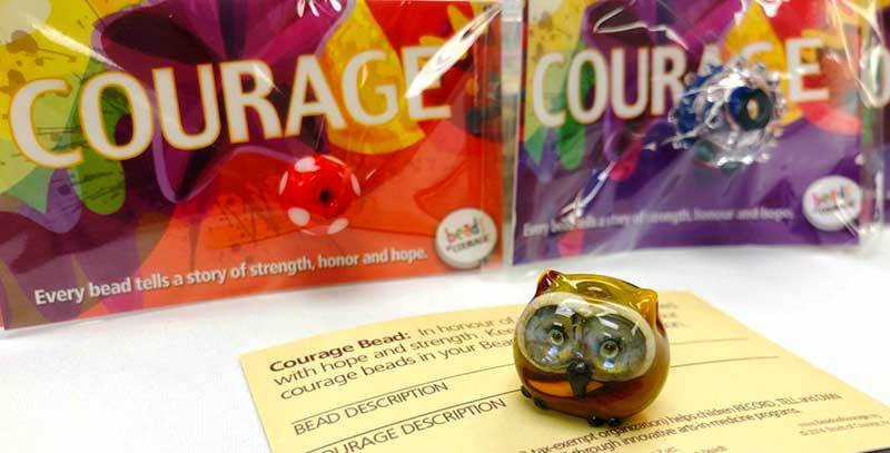 Special artist-made beads are given to children to honor acts of courage.