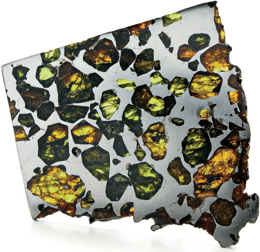 Pallasite meteorites are composed of nickel-iron studded with olivene. This slice is from the Esquel meteorite, courtesy Robert Haag; photo: Jim Lawson