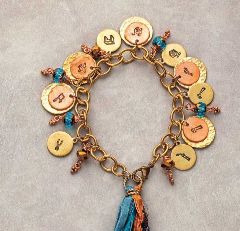 handmade jewelry gifts: Rita Pannulla's Charming Jewelry Tools--the super easy charm bracelet project that spotlights a set of 10 exclusive stamps. Photo: Jim Lawson