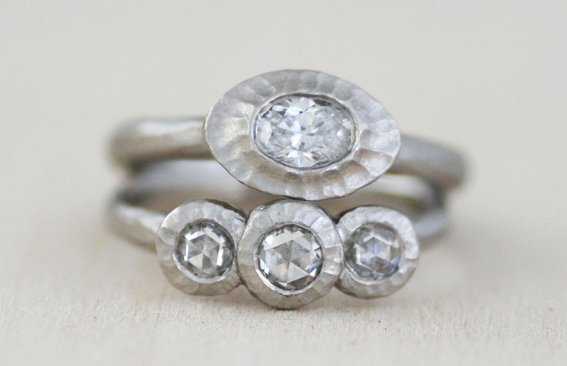 Most people think of diamonds as white or colorless. When they are near the top of the color scale, that lack of color is best displayed in 18k white gold or, as here, in platinum. Very slightly yellow diamonds--G and H in grade--will often appear whiter when set in white metal. Design by Michael Endlich, photo by Sarah Francis, courtesy Pavé Fine Jewelry.