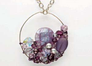 Learn how to make this beautiful pearl pendant necklace in our FREE eBook that contains 3 DIY pearl jewelry projects.