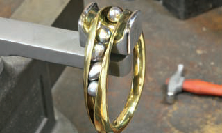 The concave design in this 3D Brass Bangle with Onyx Beads, published in Lapidary Journal Jewelry Artist January/February 2014, creates a channel that allows beads or pearls to roll around without falling out. Pearl photo: Bill Fretz. Black onyx bead photo: Jim Lawson.