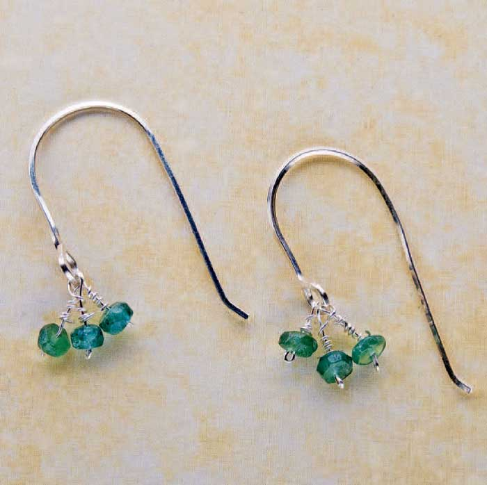 Wire earrings by Denise Peck. Made with: half hard square sterling wire, head pins, faceted apatite rondelles, round nose pliers, flush cutters, and a Sharpie or a stepped mandrel if you have one.