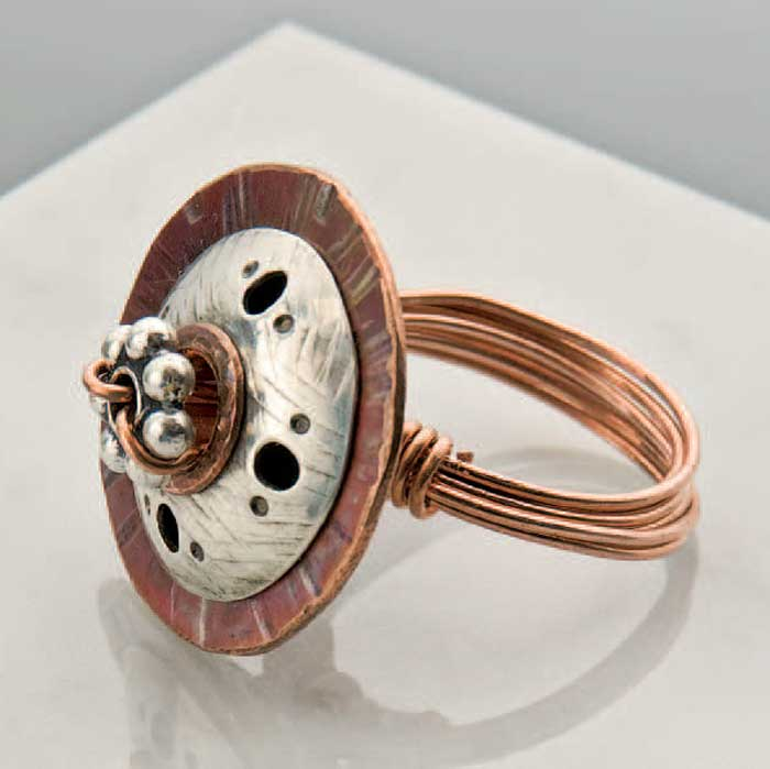 Denise Peck took a large, decorative bead and made it the main feature of the focal on a very cool ring. She connected the parts in a way that embellished the top, too.