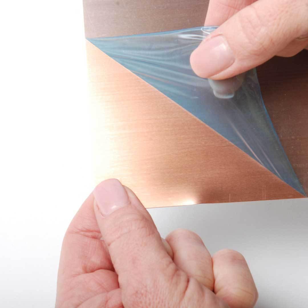 peel covering from metal sheet