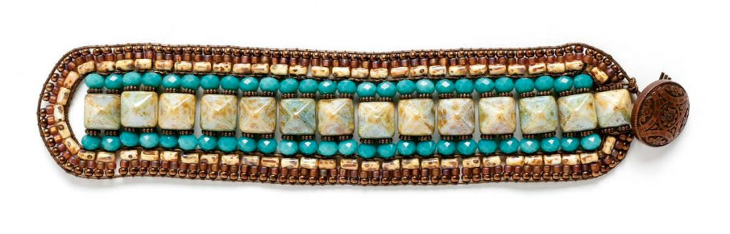 Pharoaoh's Finery Bracelety, by Michelle Gowland. Czech pyramid beads and seed beads stitched to leather cording to form leather bracelet