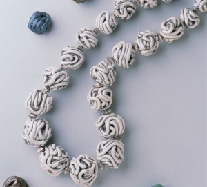 Use this simple process to begin making polymer clay beads to make a handmade beaded necklace.