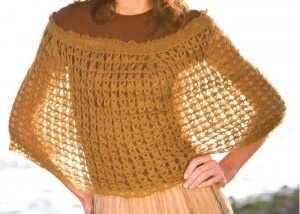 The Broomstick Lace Capelet combines traditional crochet techniques to develop this free crochet poncho pattern.