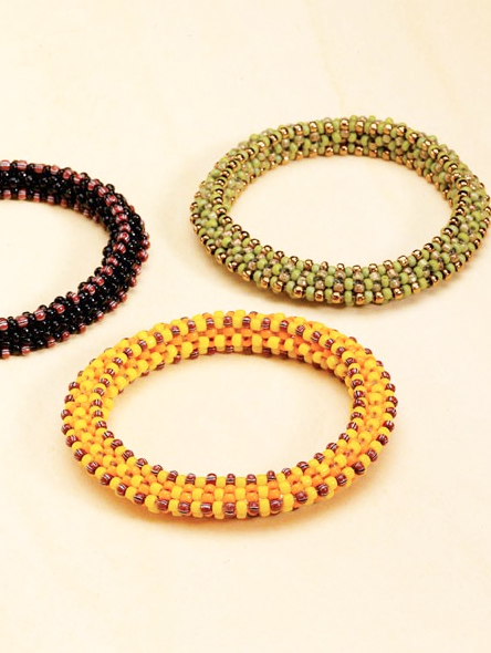 """""""Ridgeback Bangles,"""" by Karin Salomon, a rope of cubic right-angle weave embellished with a  pattern of seed beads"""
