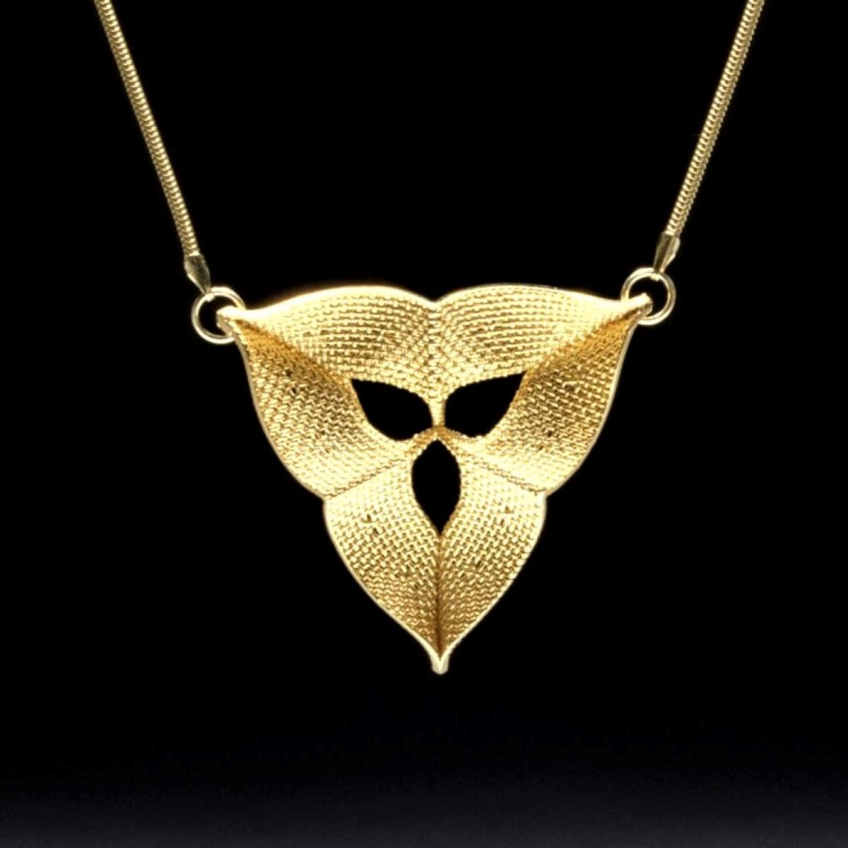 Mesh pendant plated with gold by Dennis Nahabetian