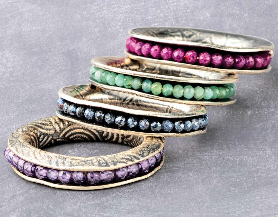 Eva Sherman spinner ring with beads