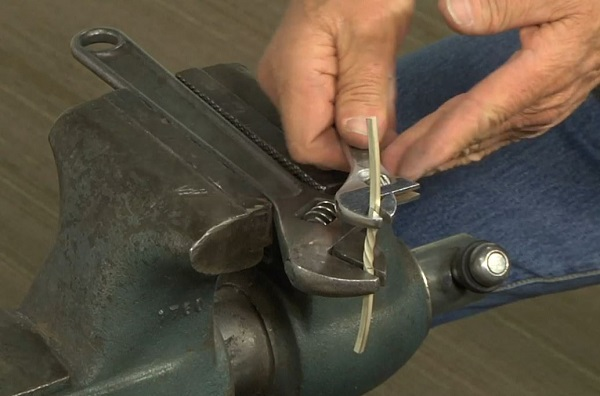 use a wrench in a vise for metalsmithing tasks with metal and wire