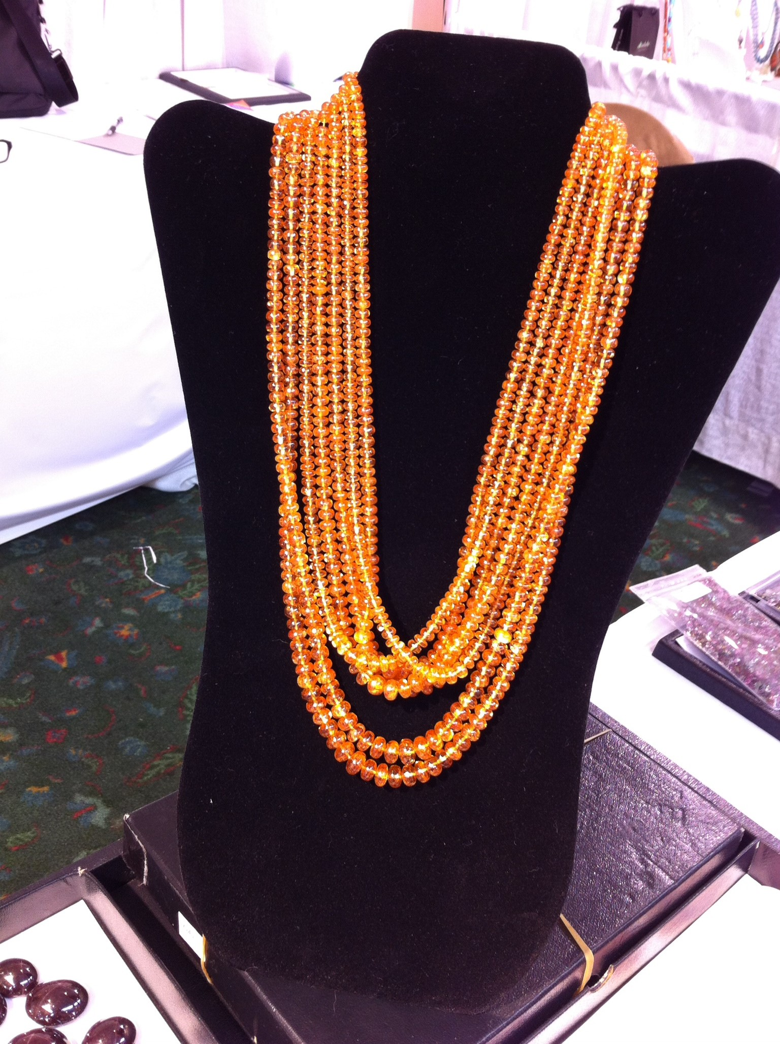 I can't pass up orange, so of course, a couple of years ago in Tucson, I had to snap a photo of this multistrand necklace of spessartine beads from Mahey Gems & Jewellery Ltd; photo: M. White