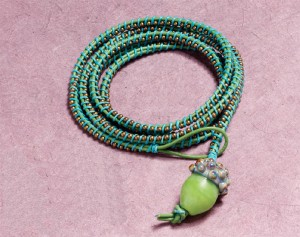 Spring Acorn Wrap Bracelet, by Cynthia Deis. leather cording, contrasting waxed linen, lampworked bead