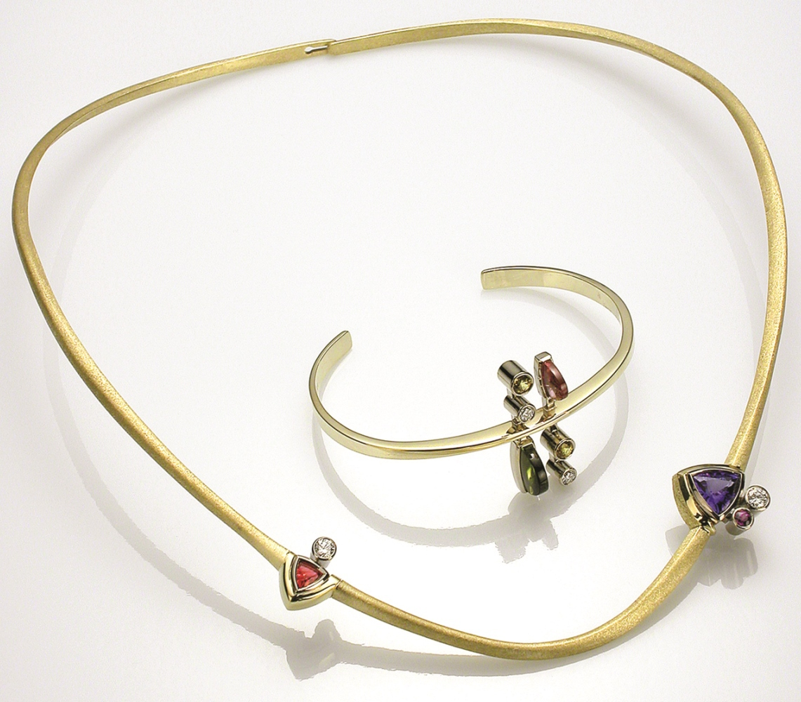 Michael David Sturlin hand forged and fabricated this cantilevered neckring and bracelet in 18K gold. Neckring features tanzanite, red spinel, purple sapphire, and diamond; bracelet features pink tourmaline, green tourmaline, yellow sapphire, and diamond. Photo: Robert Diamante
