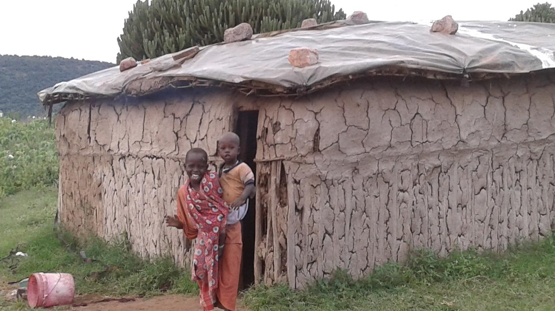 children at hut near gemstone mines