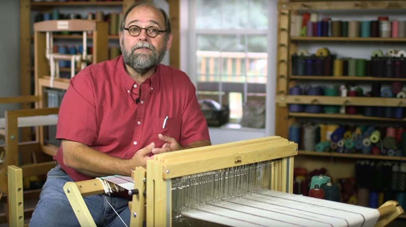 """Tom Knisely in <em><a href=""""https://www.interweave.com/store/learn-to-weave-making-good-cloth-multi-shaft-loom-video-download"""" target=""""_blank"""">Learn to Weave</a></em>"""