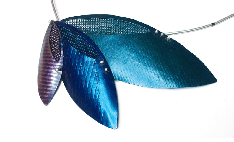 Recycled materials are still in, Trends reports in the March/April issue of Lapidary Journal Jewelry Artist. Falling Leaf Necklace, enamel mesh, by Laura Thul Penza.