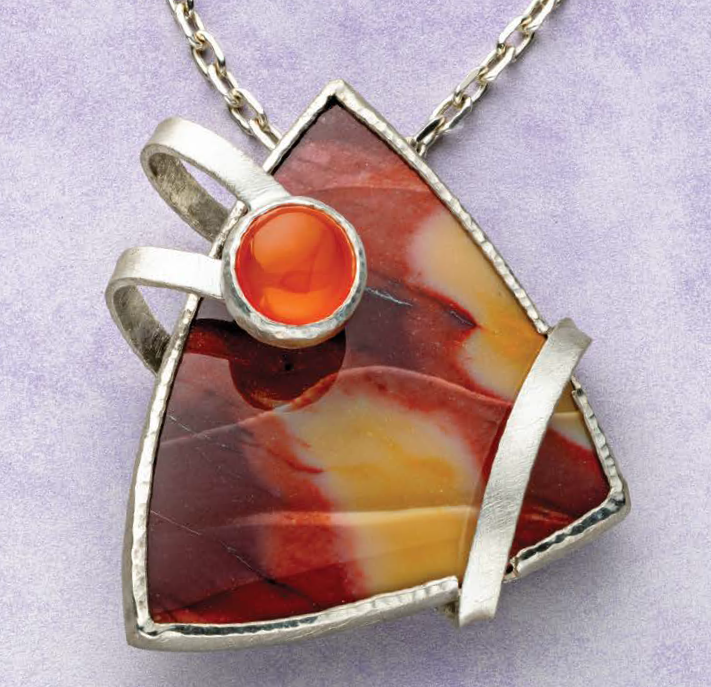 """""""In Orbit"""" pendant by Mary van der Aa, carved mookaite cab, citrine cab accent, silver wrap-around. The project appears in <i>Lapidary Journal Jewelry Artist</i> January/February 2019; photo: Jim Lawson"""