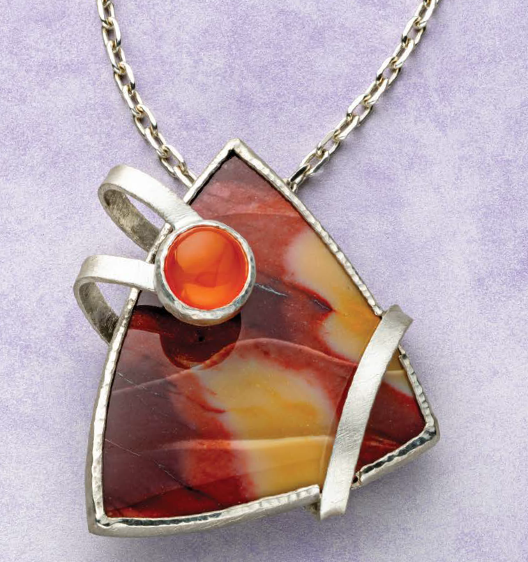 Mary Van der Aa is drawn to the infinite variety in colored stones. She developed the special setting in this pendant for a very special carved mookaite cabochon and shared how she did it in her In Orbit pendant in Lapidary Journal Jewelry Artist January/February 2019. Photo: Jim Lawson