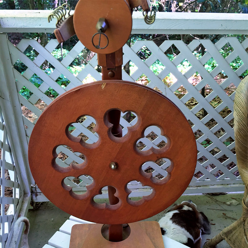 T came home from Earth Day with a vintage wheel to rehab and reuse. Photo by Deborah Held