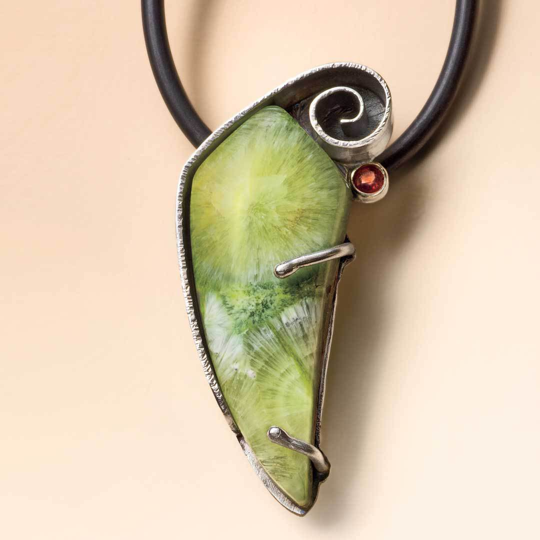 """""""I chose to design with the wavellite cabochon because the color and shape appealed to me. The stone dictated a delicate piece and made for a great final design in my soldering series."""" -- Lexi EricksonWavellite Pendant by Lexi Erickson, Lapidary Journal Jewelry Artist, December 2011."""