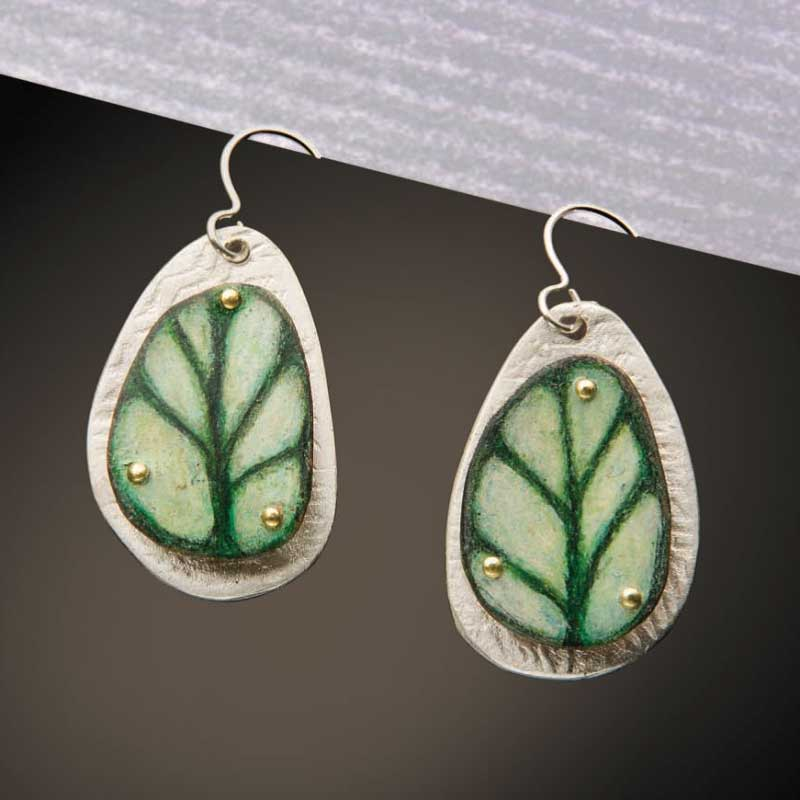 Dev Weld's colored pencil earrings could be enlarged to be the perfect jewelry design to use as a holiday ornament.