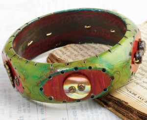 Learn how to make mixed-media jewelry in this FREE eBook, such as this wood bracelet.