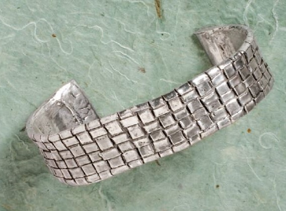 woven PMC sheet metal clay cuff by Kathy St. Martin