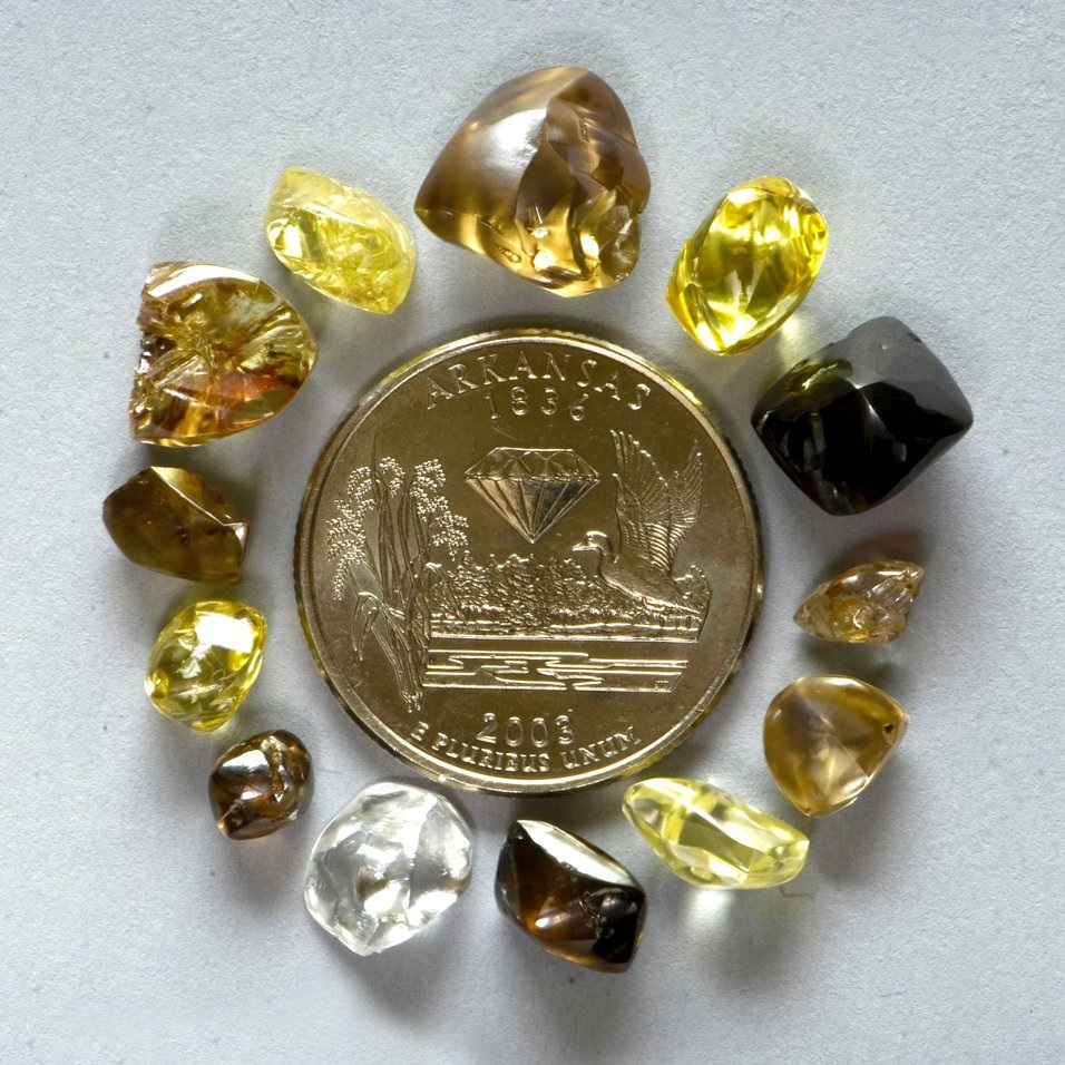 A selection of Arkansas diamonds around the Arkansas Quarter, first year of issue. Photo courtesy Arkansas Department of Parks and Tourism.